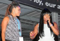 Dancehall icon Lady Saw shares a fun on-stage moment with a local attendee